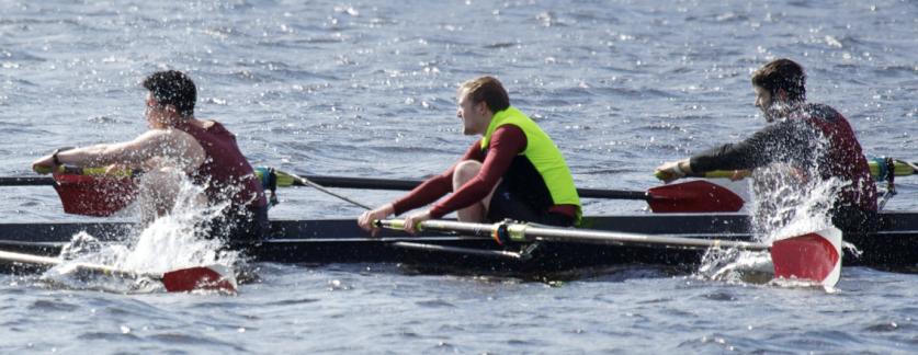 crew rowing choppily